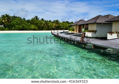 beauty of exotic island - maldives. Beach villas near ocean #416369323