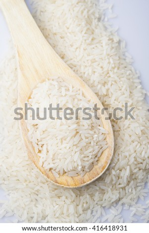 food background. brown rice in a wooden spoon. top view #416418931