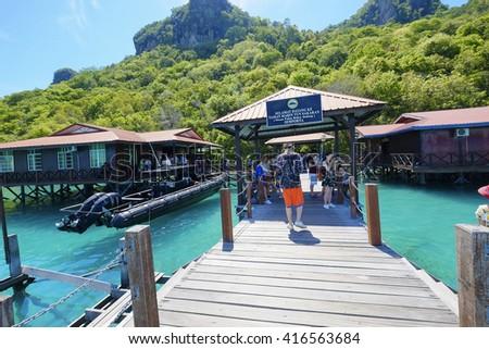 Sabah , Malaysia - May 6 2016 : wooden jetty heading towards the Bohey Dulang island. Sabah National Park Semporna. ( Tun Sakaran Marine Park ) #416563684