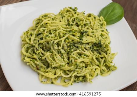 Pasta with pesto Brazilian. Wooden table  #416591275
