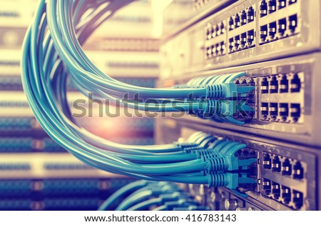 Network cable and switch,Data Center Concept. #416783143