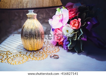 still life with wedding bouquet and rings #416827141
