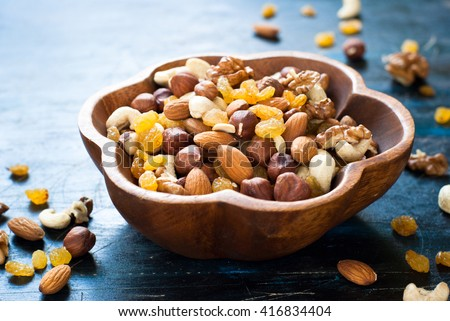 A Mix of variety nuts in a wooden bowl. #416834404