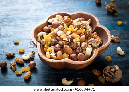 A Mix of variety nuts in a wooden bowl. #416834491