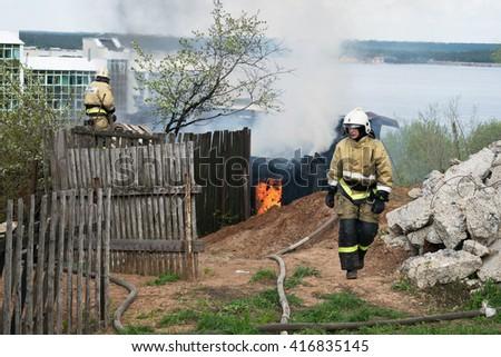 Cheboksary, Russia - May 7, 2016: Firefighters extinguish a fire in the city Cheboksary, Chuvashia #416835145