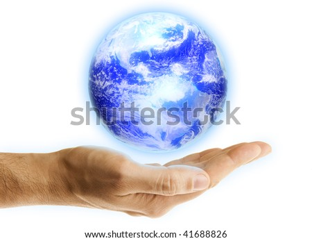 Glowing blue earth in a hand on white background #41688826
