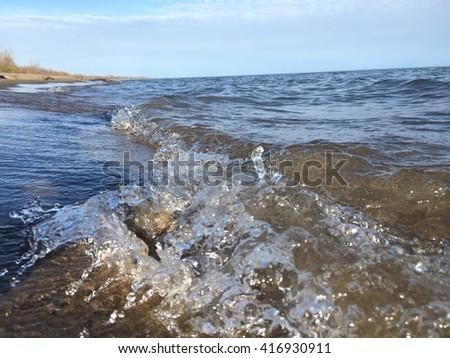 Water crashing on the beach #416930911
