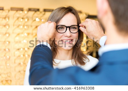 View of a Young attractive  woman testing new glasses with optician #416963308