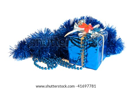 Xmas blue decorative wrapped present and beads on white background #41697781