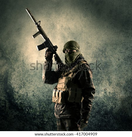 Portrait of a heavily armed masked soldier with grungy background concept #417004909