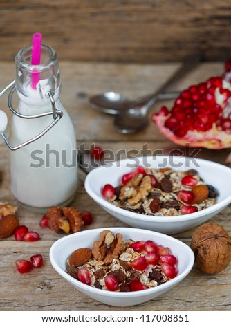 Granola with nuts, raisins and pomegranate. Healthy Breakfast. Selective focus #417008851