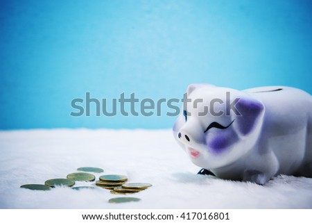 Piggy Bank, Pig, Savings, Piggy bank with copy space on blue background. #417016801