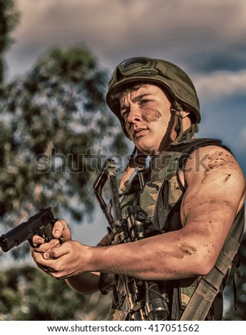 young a soldier in the uniform with weapon #417051562
