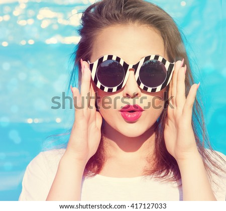 Colorful portrait of young attractive woman wearing sunglasses. Summer beauty  concept Royalty-Free Stock Photo #417127033