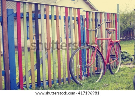 Vintage Bicycle /summer background with bicycle (toned picture)