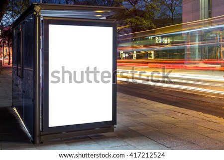 Blank white mock up of vertical light box in a bus stop at night Royalty-Free Stock Photo #417212524