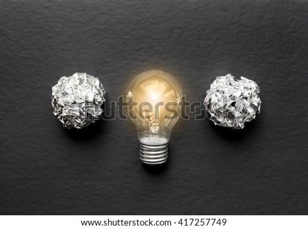 concept of idea illustration lit lamp on black background #417257749