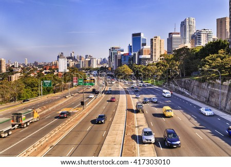 Warringah freeway endless lanes going through North Sydney from Sydney CBD, Bridge and modern skyscrapers. Blurred cars in both directions on a bright sunny day. Royalty-Free Stock Photo #417303010