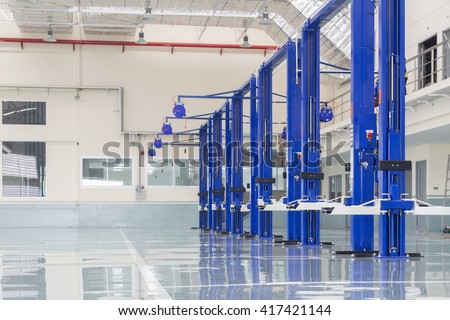 interior car-care center. The electric lift for cars in the service #417421144