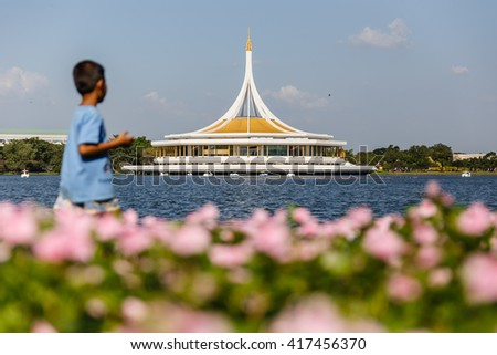 Rama IX Park with Pink Flowers and Child in the Front #417456370