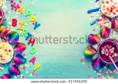 Happy birthday party background with text, drinks, cupcake and colorful tools, top view. Happy birthday greeting card