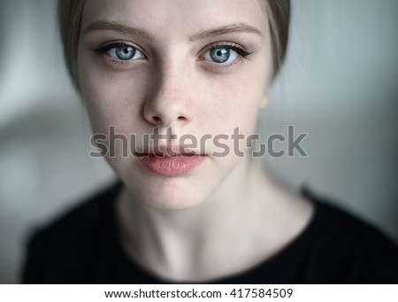 Natural portrait of a beautiful young girl close-up