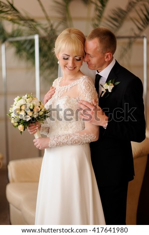 Happy bride and groom on their wedding day #417641980