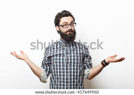 Bearded hipster young man wearing glasses doubting with his hands isolated on white background