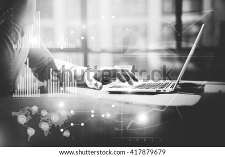 Business concept.Businessman working investment startup project modern office.Work hard contemporary laptop.Worldwide connection technology,stock exchanges graphics interfaces.Horizontal. Black white