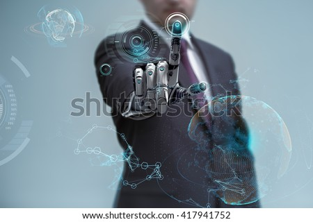 businessman operating virtual hud interface and manipulating elements with robotic hand. Blue holographic screen artificial design concept. Royalty-Free Stock Photo #417941752