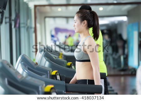 young asian people working out in modern gym #418037134