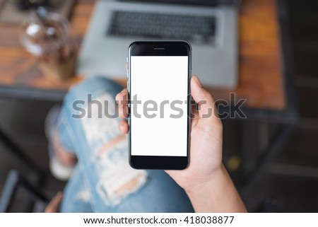 girl using smartphone in cafe. white screen.