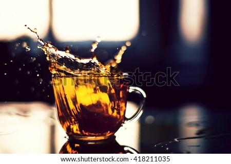 Tea splashing #418211035