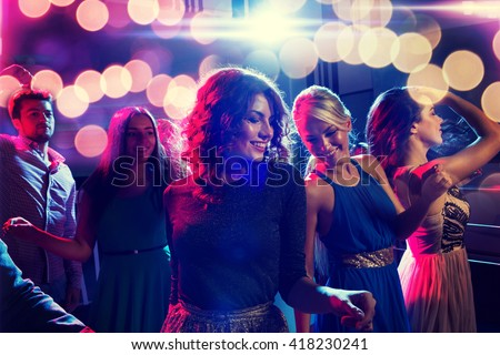 party, holidays, celebration, nightlife and people concept - smiling friends dancing in club Royalty-Free Stock Photo #418230241