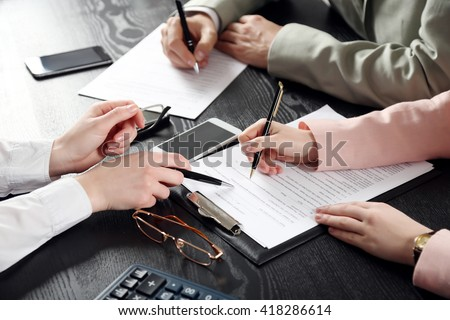 Human hands working with documents at the desk closeup Royalty-Free Stock Photo #418286614