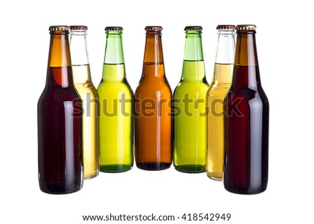 Group of unlabeled variety of beer bottles isolated on a white background.  The bottles are different colors to show variety. #418542949