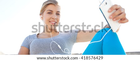 Panoramic portrait of beautiful teenager girl sitting against sunny sky outdoors, using smart phone technology to listen to music, looking thoughtful, exercise break. Sport lifestyle, exterior. #418576429