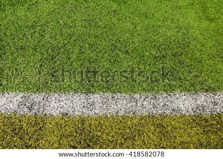White line on the green grass of a soccer field #418582078