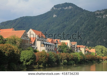 scenic picture of a village Frohnleiten , Austria with mountains in the background #418736230