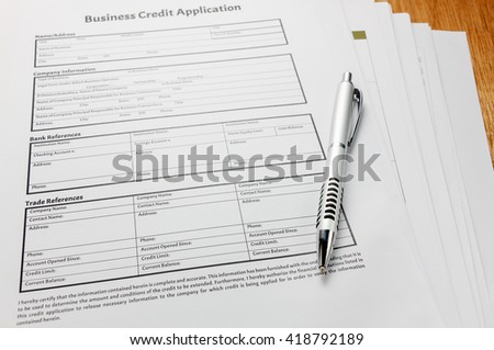 Selective focus Business credit application form and ball paint on table wood background.