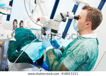 Dentist using  microscope for operation #418815211