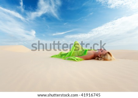 Beautiful woman sleeping in the middle of desert #41916745