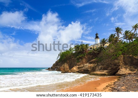 Puerto Rico coastline beach at Punta Tuna lighthouse in summer with a blue sky and clouds Royalty-Free Stock Photo #419173435