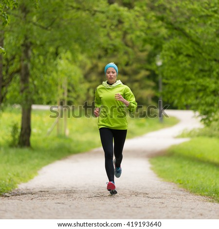 Sporty young female runner in city park.  Running woman. Female runner during outdoor workout in nature. Fitness model outdoors. Weight Loss. Healthy lifestyle.  #419193640