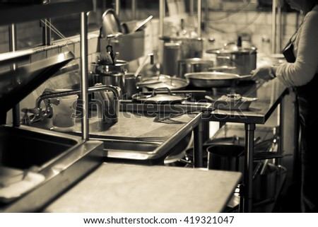 A black and white photograph of a professional kitchen in a New York City restaurant #419321047