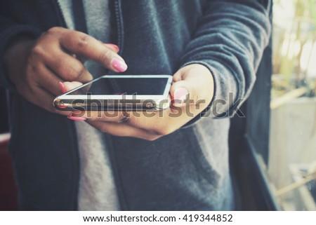 Woman using smart phone #419344852