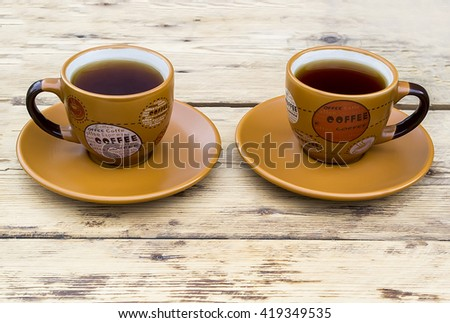 orange coffee Cups on a wooden table #419349535
