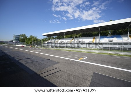 Monza, Italy - May 03, 2016 : tribunes of the Monza circuit without people during a course of fast sports cars Guide #419431399
