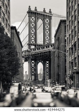 Manhattan Bridge and Empire State Building seen from Brooklyn, New York. Black and white image with a blurred foreground #419444275