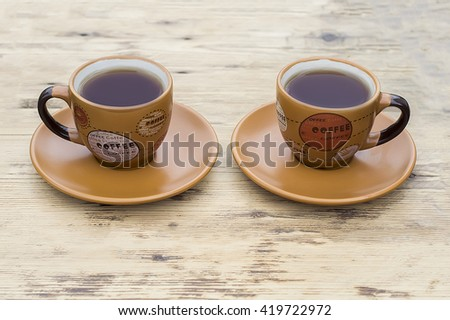 coffee Cup on a wooden table #419722972